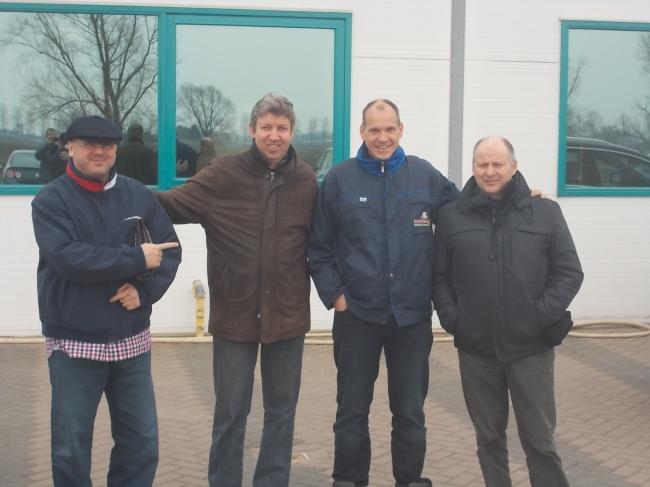 """Folrea Sorin, Vincent van de Kerk, Jan Hooymans and Freddy Vandenheede in front of the offices of """"Hooymans Company""""."""